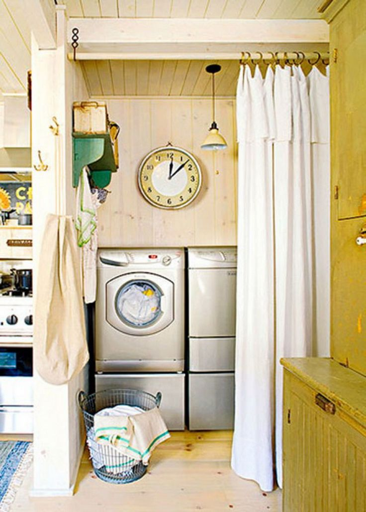 A perfect example of how a laundry room doesn't have to be a separate room with some clever #design. Simply using a curtain to section off and hide the washer and dryer from another room allows for more space. (Ciiwa.com)