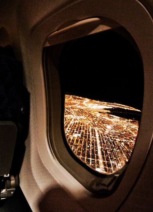 seeing the new york city lights out the airplane window upon arrival is one of the best sights.