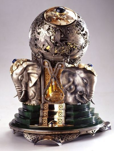 Faberge....simply a one-of-a-kind unique treasure and unfortunately not sure of exact purpose..however, there is a covered round box on top.