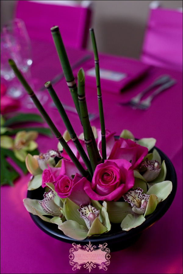 Asian inspired centerpiece with dahlias, bamboo, orchids and roses. Events in Bloom, K & K photography