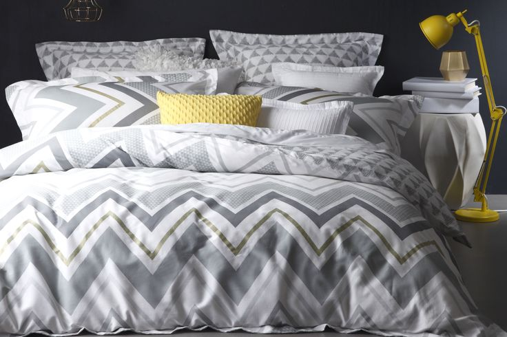 The Reagan Pewter Duvet Cover Set is a fashion statement with it's contemporary metallic print, modern chevron stripes and geometrics.