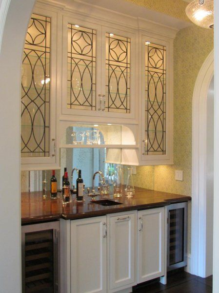 The mirror backsplash and the details on the glass door cabinets really make this wet bar! Kitchens We Love at Design Connection, Inc. | Kansas City Interior Design http://www.DesignConnectionInc.com/Blog #GlassDoors #MirrorBacksplash #InteriorDesign