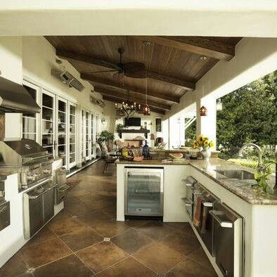 LOVE this outdoor kitchen and covered patio!