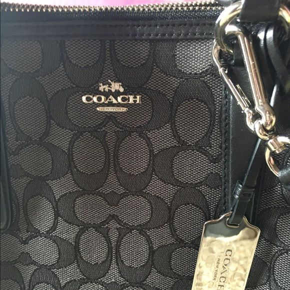 BNWOT Coach Crosby Carry All Purse Brand New Purse I bought when m old one got messed up but I decided I'd rather stay with my Edie and sell this one! Never used comes with white wash bag and special cleaner I bought extra for my coach rain/snow boots & flip flops but works on purses as well! No flaws pristine condition! Coach Bags Shoulder Bags