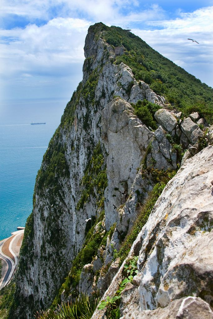 Rock of Gibraltar - monolithic limestone promontory located in the British overseas territory of Gibraltar, off the southwestern tip of Europe on the Iberian Peninsula