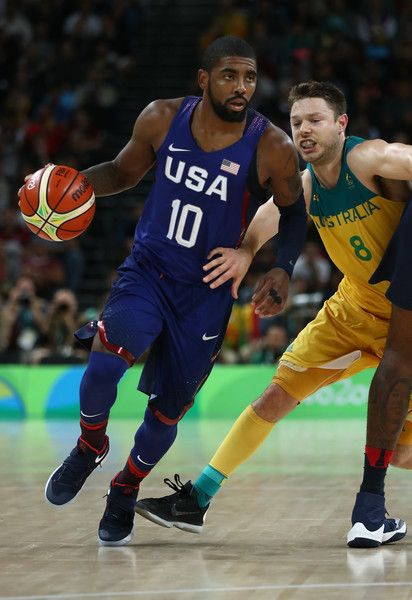 Matthew Dellavedova Photos - Kyrie Irving #10 of United States moves the ball past Matthew Dellavedova #8 of Australia during a Preliminary Round Basketball game between Australia and the United States on Day 5 of the Rio 2016 Olympic Games at Carioca Arena 1 on August 10, 2016 in Rio de Janeiro, Brazil. - Basketball - Olympics: Day 5