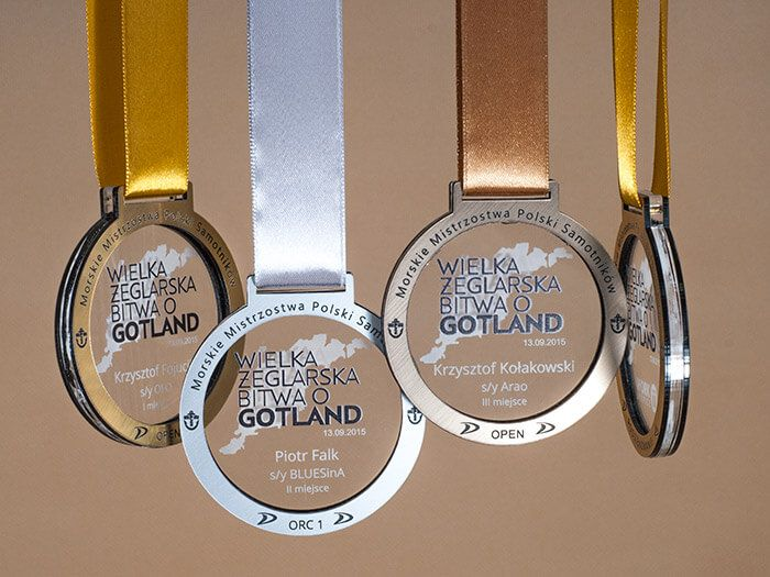 Sport medals - Maritime Polish Championship. The original medals from transparent plexiglass engraved and laminate engraving.