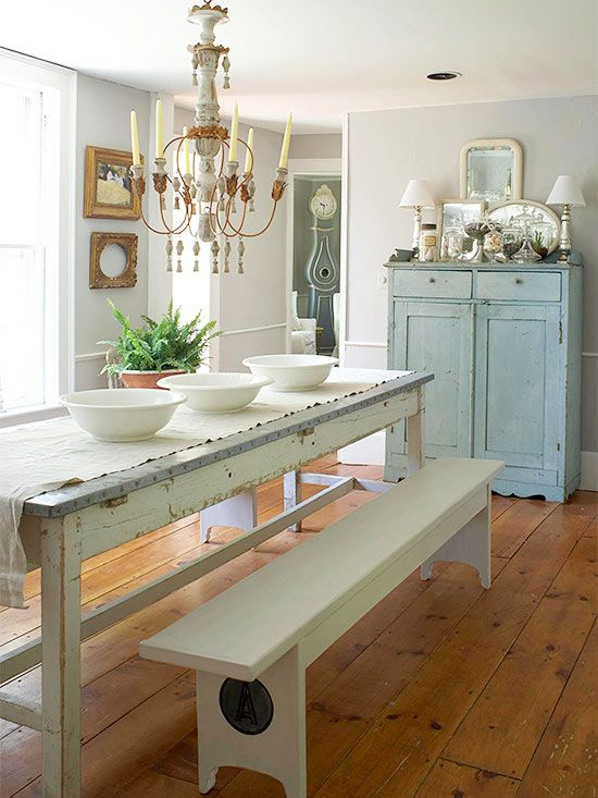 Zinc Topped Farmhouse Table and Benches - mismatched flea market furniture finds work well together when painted different shades of white + complementary colors - Natural Patina - via BHG