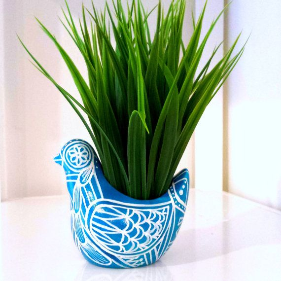 Hey, I found this really awesome Etsy listing at https://www.etsy.com/listing/115151078/bird-planter-ceramic-painted-turquoise