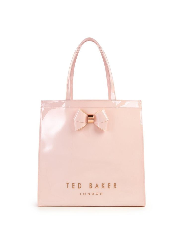 Ted Baker Bow Icon Large Shopper - Baby Pink Transport your treasures in the same sartorial style that Ted Baker's designs have become renowned for, with this bow icon large shopper bag. Roomy enough to store all of your essentials and then some, its patent shine, subtle branding and gold-toned bow promise equal parts fashion and function. Wear it over your shoulder with your favourite Ted Baker jeans, floral flats and a basic tee for a feminine finish on shopping-in-the-city days!Material…