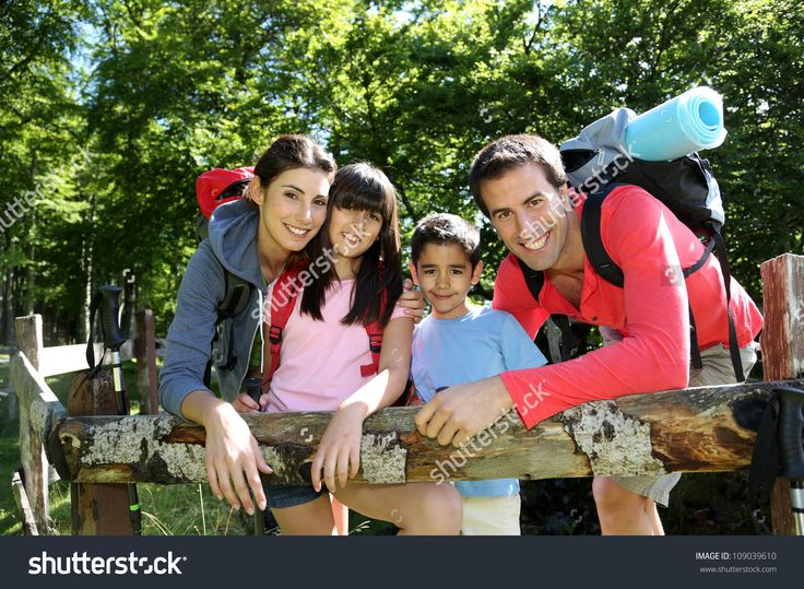 Family On A Hiking Day Resting Along Fence Stock Photo 109039610 : Shutterstock