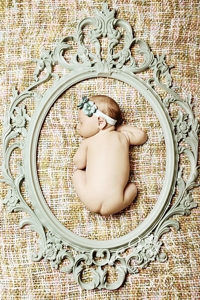 Place an empty frame around sleeping baby.  Adorable and easily posable shot without torturing baby!!  Win-win!