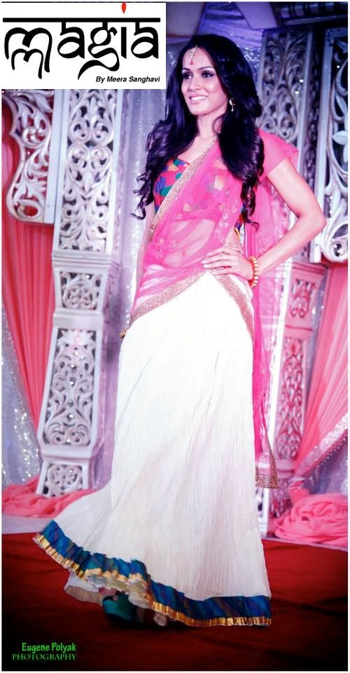 Reshme Rau wearing this simple white crushed cotton lehenga with a multicolored blouse and a net dupatta with a touch of gold embroidery.