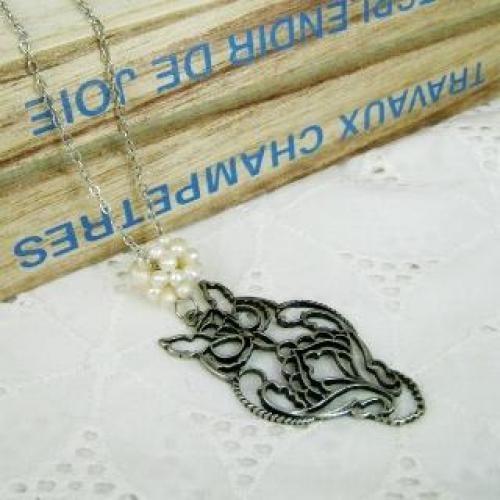 Elegant Owl Pearl Necklace