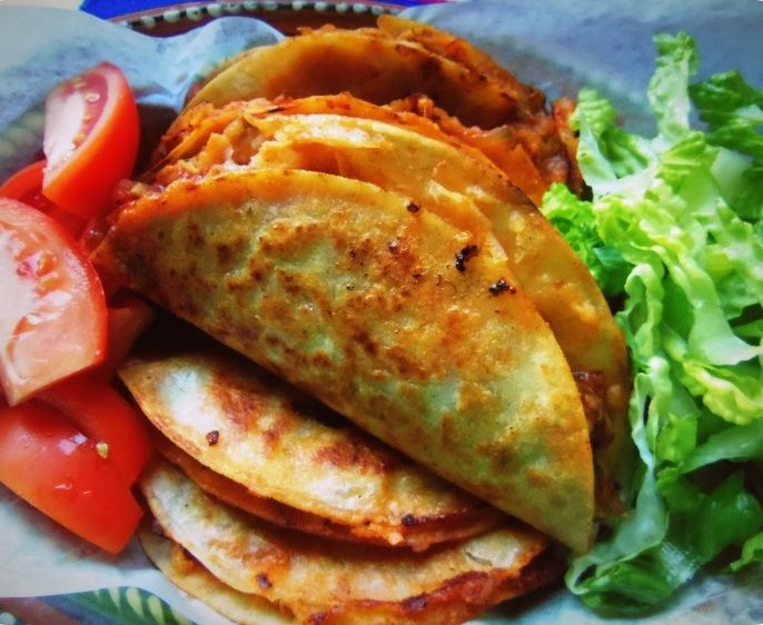 Tacos de Canasta Filled with Spicy Potatoes and Cheese HispanicKitchen.com