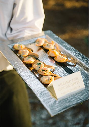 Shrimp & Gouda grits on an edible spoon by the PPHG culinary team | Passed hors d'oeuvres for your holiday or end-of-year party | Lowndes Grove Plantation in Charleston, SC | Photo by Aaron and Jillian Photography