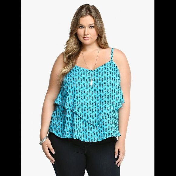 Teal Pineapple Print Flowy Cami. PLUS SIZE! Take a tropical detour in this lightweight teal cami. It has a a cool pineapple print that's perfect for a sunny day. A handkerchief hem and crisscross back make this flared and flowy look a keeper. SUPER CUTE!!! Tops