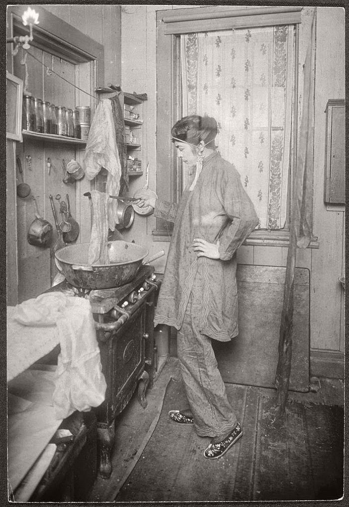 """Allison at her kitchen stove, dying scarves, ca. 1912-1920. from New York's Bohemian Greenwich Village (1910s – 1920s). Jessie Tarbox Beals (1870 – 1942) was an American photographer, the first published female photojournalist in the United States mostly known for her portraits of places such as Bohemian Greenwich Village. Greenwich Village became widely identified as America's bohemia by the mid-1910s."""