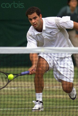 2000 - Pete Sampras returns a deep forehand stop at the net during his Men's Singles final at the Wimbledon 2000 tennis tournament against Australian Patrick Rafter.