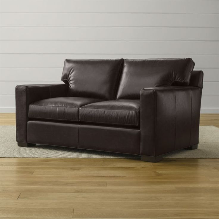 Shop Axis Brown Leather Loveseat. Track arms create a clean look, and low back cushions and deep seats encourage lounging. Not surprisingly, Axis has been a customer favorite for more than a decade.
