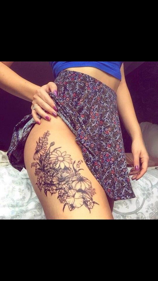 Flower thigh tattoo
