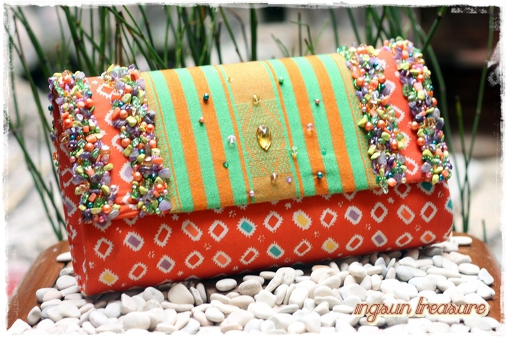 A fresh combination between green NTB tenun and orange stamped batik jumputan.    #clutchbag #clutch #batikbag #indonesia #ethnicbag #traditional #batik