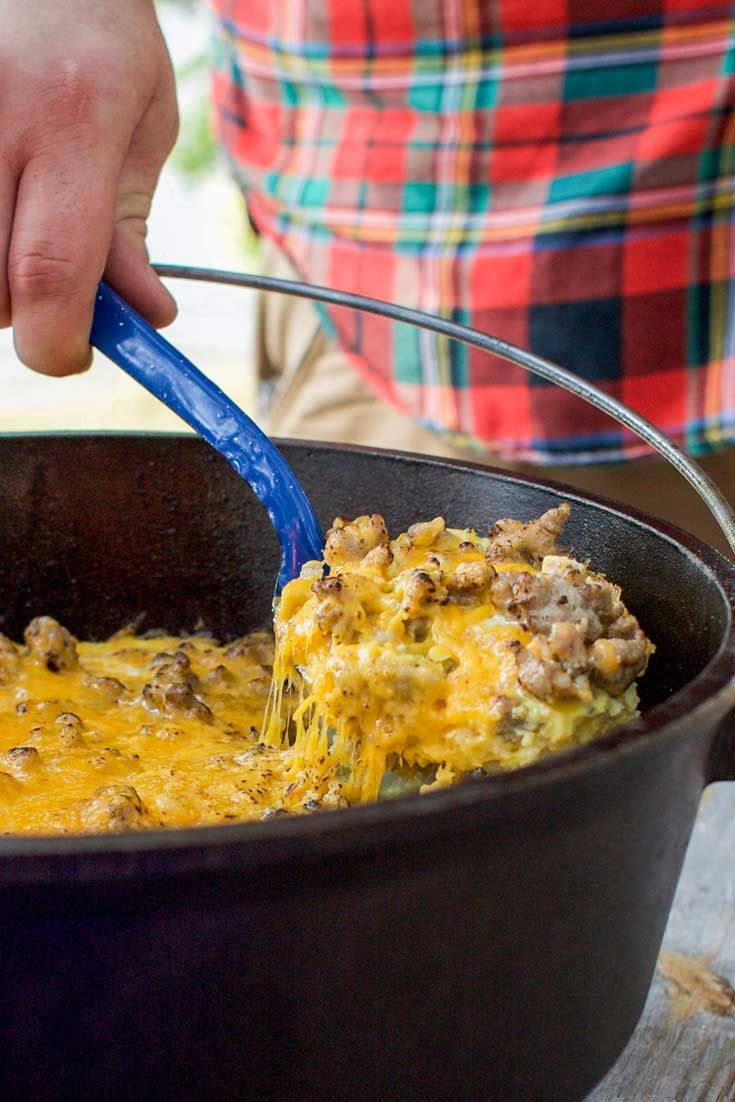 A hearty camp cooking breakfast filled with sausage, hash browns and eggs cooked in a camp dutch oven.
