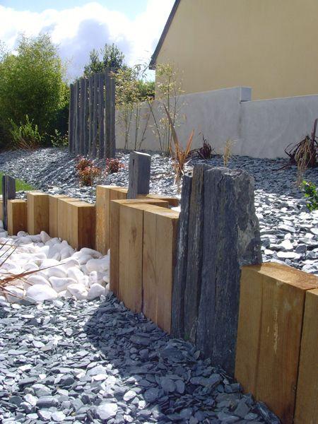 Muret traverse bois piquet schiste ardoise galets blanc vitre laval jpg 450 600 pixels for Piquet en ardoise