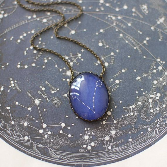 Zodiac constellation necklace - sign of Pisces (19 February - 20 March). The necklace is made from bronze tone metal and a clear glass dome.