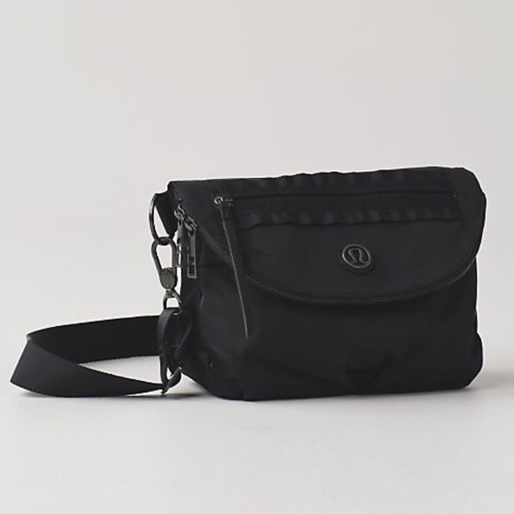 Lululemon festival bag purse tote black Like new only used a few times. Looks brand-new. Lululemon festival bag. Colors black. Can be used as a purse, fanny pack, or cross body bag . From a pet free smoke free home. lululemon athletica Bags Crossbody Bags