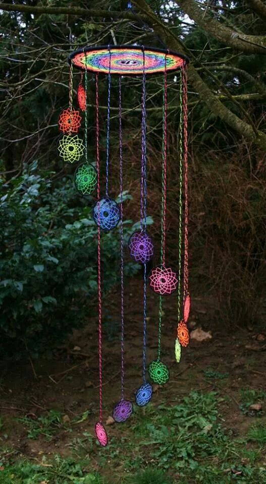 Colorful Mandela looking wind chimes. Rainbow colors.