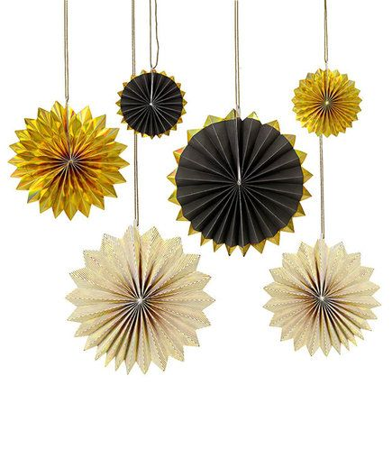 Gold Pinwheel Decorations | Throwing a big bash to celebrate the New Year? Set the scene for an elegant soiree with these unique and festive decorations.