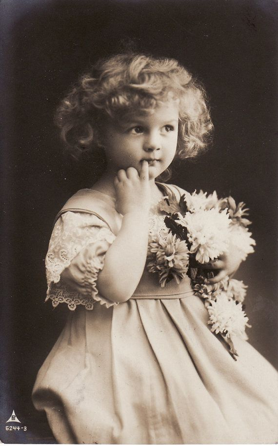 1910...Sweet Little Girl....Curly Hair....Flower Bouquet...Victorian...original vintage postcard