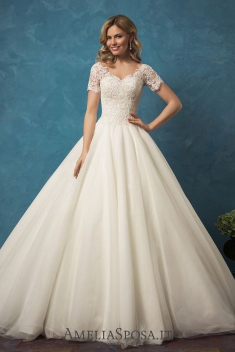 Wedding dress Alyssa - AmeliaSposa.  Classic ball gown with a train for a sophisticated ceremony. This multi-layer skirt reminds a weightless cloud that plays with the wind. Luxury laces of a top finish focus your attention on the back being one of the season's key trends.