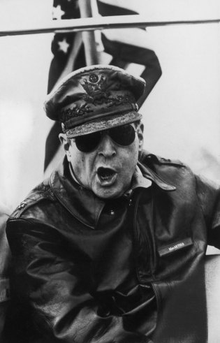 Gen. Douglas MacArthur roars orders from the bridge of the flagship USS Mount McKinley during an assault on the Inchon beachheads during the Korean War, 1950. By Carl Mydans.