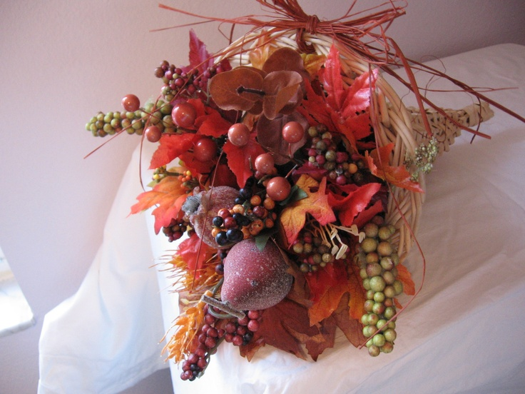 A fall cornucopia of silk flowers, vegetables and eucalptus. $24.00