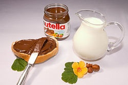 Nutella (Italian pronunciation:[nuˈtɛlla]; English:/nʌˈtɛlə/ or /nuˈtɛlə/) is the brand name of a chocolate spread.  Nutella, manufactured by the Italian company Ferrero, was introduced on the market in 1963. The recipe was developed from an earlier Ferrero spread released in 1944. Nutella is now sold in over 75 countries. Eat it with real italian bread!