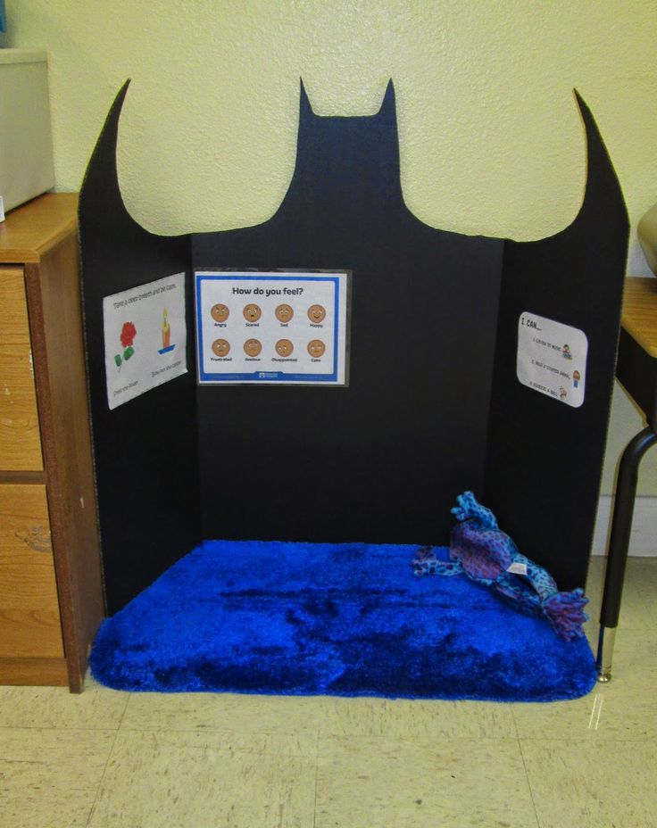 """This is our """"Bat Cave"""" a calming area for children. Emotion poster (will add small mirror), """"I can ..."""" poster, and How to calm down (smell a flower, blow out a candle)."""