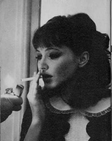 """""""Got a light?"""" """"I came 6000 miles to give it to you."""" Natacha. Alphaville. 1965."""