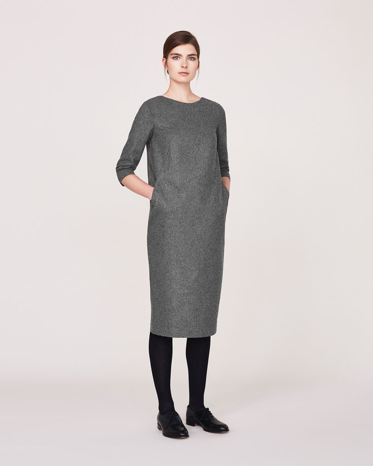 TOAST Wool blend dress in a gentle cocoon shape with two slip-in pockets.