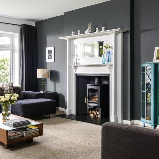 The #charnwood C-Five wood burning stove looks right at home. Love the contrasting colours and the mix of traditional / contemporary furniture
