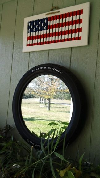Flag made out of old shutter and mirror framed with a Harley-Davidson tire