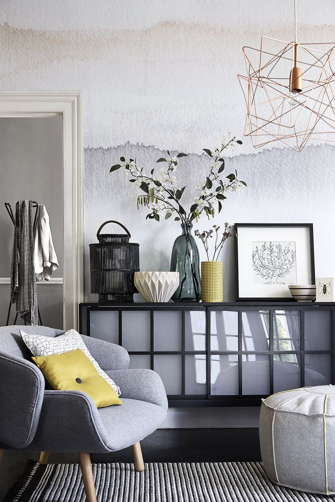 Go for a pared-back setting where east meets west. A stunning watercolour-effect wallpaper creates a beautiful backdrop for a statement sideboard and eastern-inspired accessories. Photography: Mark Scott. Find more living room ideas at housebeautiful.co.uk