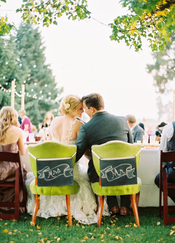 mr and mrs signs on fabulous green chairs