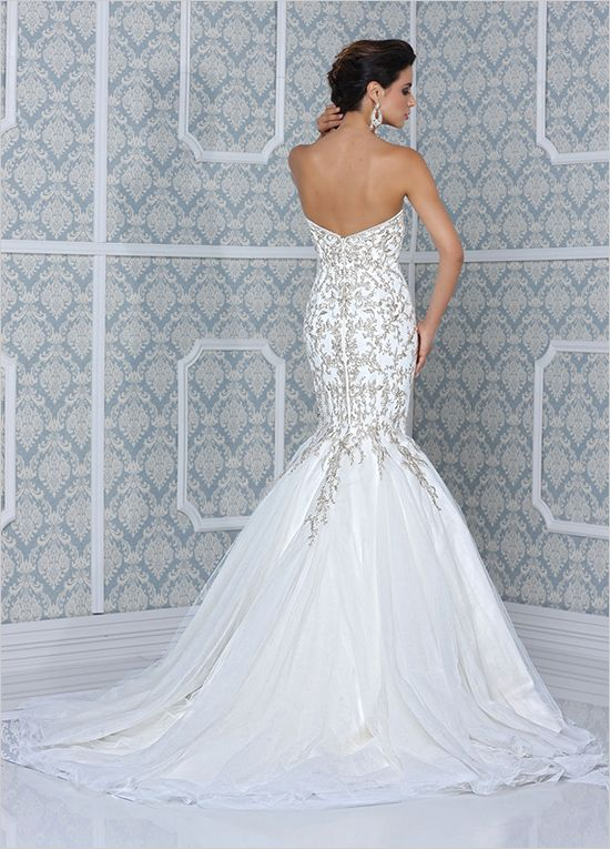 mermaid style wedding gown with gold embroidery by Impression Bridal #mermaidstyledress #weddingdress #weddingchicks http://www.weddingchicks.com/2014/03/11/impression-bridal-wedding-gowns/