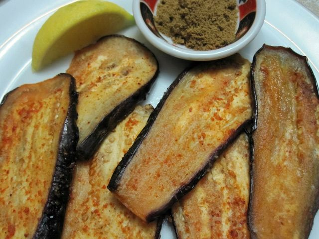 Eggplant slices are seasoned with olive oil and Moroccan spices for a simple but tasty side dish.