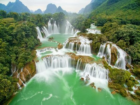 Ban Gioc waterfall in the far northern Vietnamese province of Cao Bang is one of the most popular sites in the region, which boasts a famed karst landscape of striking limestone peaks.