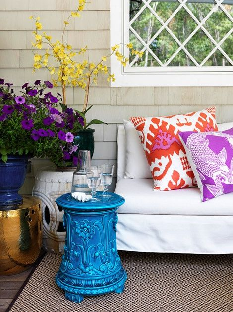 Love pillow prints & color combos of tables, flowers & pillows.  Vibrant.