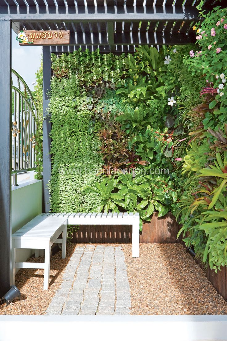 Vertical garden design with orchids space saving backyard landscaping - Vertical Garden By Baanlaesuan Com
