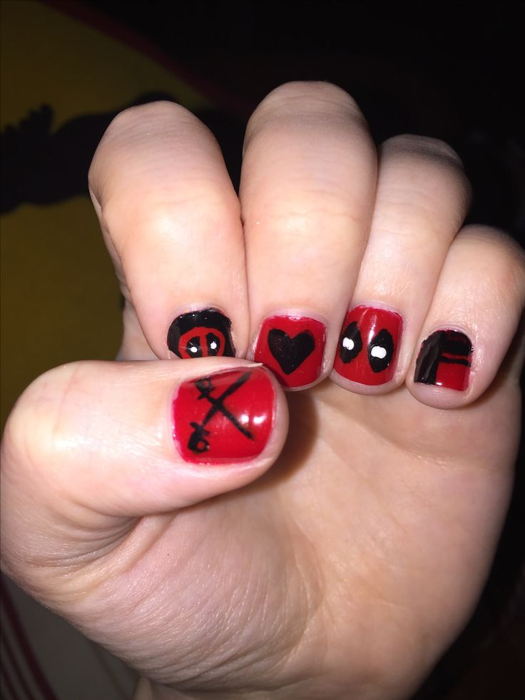 Dead pool nail art. I forgot to take a picture when i was done so they are a little chipped.